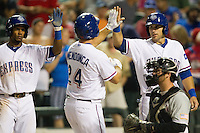 Round Rock Express outfielder Julio Borbon #20 and catcher Dusty Brown #2 greet Tommy Mendonca #24 after he homered during the Pacific Coast League baseball game against the Sacramento River Cats on May 22, 2012 at The Dell Diamond in Round Rock, Texas. The Express defeated the River Cats 11-5. (Andrew Woolley/Four Seam Images)