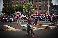 "A ""diablo cojuelo"" from la vega take part during the Bronx Dominican parade in New York July 28, 2013 by Kena Betancur / VIEWpress"