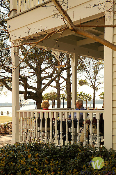 Restored waterfront park, Beaufort, SC. Couple on Old Point Inn porch.
