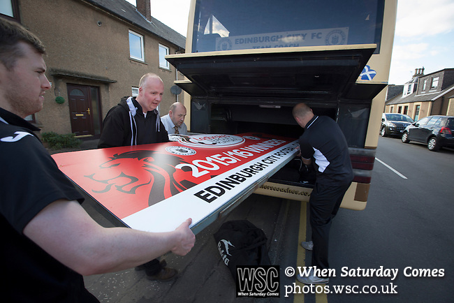 East Stirlingshire 0 Edinburgh City 1, 14/05/2016. Ochilview, Scottish League Pyramid Play Off. Visiting officials struggling to get the promotion sign on board the team bus after East Stirlingshire hosted Edinburgh City in the second leg of the Scottish League pyramid play-off at Ochilview Park, Stenhousemuir. The play-offs were introduced in 2015 with the winners of the Highland and Lowland Leagues playing-off for the chance to play the club which finished bottom of Scottish League 2. Edinburgh City won the match 1-0 giving them a 2-1 aggregate victory making them the first club in Scottish League history to be promoted into the league. Photo by Colin McPherson.