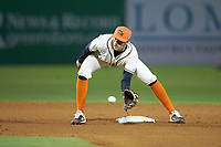 Greensboro Grasshoppers shortstop Connor Kaiser (18) fields a throw at second base between innings of the game against the Hagerstown Suns at First National Bank Field on April 6, 2019 in Greensboro, North Carolina. The Suns defeated the Grasshoppers 6-5. (Brian Westerholt/Four Seam Images)