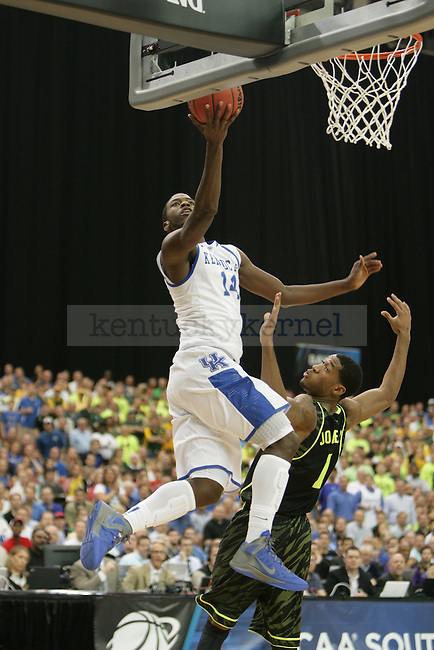 UK freshman forward Michael Kidd-Gilchrist gets a layup during transition during the first half of the UK vs. Baylor South Regional Finals at the Georgia Dome in Atlanta,  March 25, 2012. Photo by Brandon Goodwin | Staff