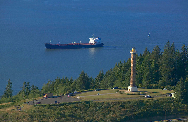 Freighter on Columbia River passing Astoria Column