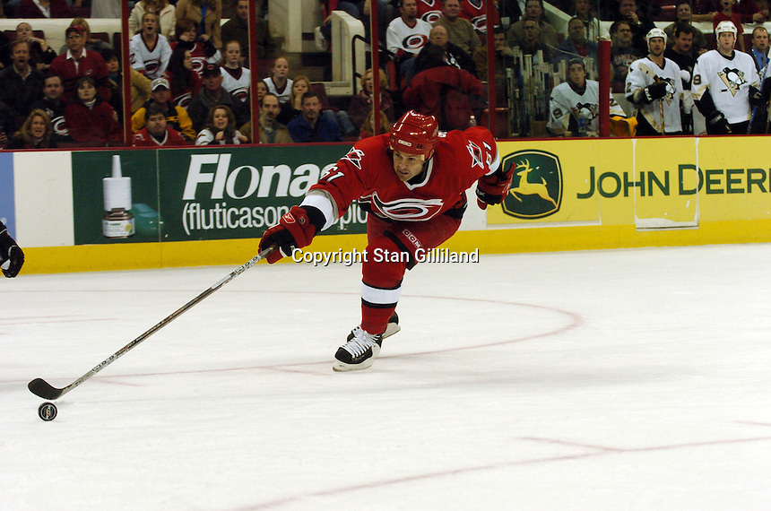 Carolina Hurricanes' Cory Stillman reaches for a puck against the Pittsburgh Penguins in Raleigh, NC Friday, February 10, 2006. The Penguins won the game 4-3.