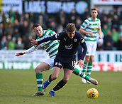 17th March 2019, Dens Park, Dundee, Scotland; Ladbrokes Premiership football, Dundee versus Celtic; Callum McGregor of Celtic challenges Ethan Robson of Dundee
