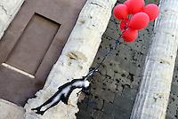 Roma, 12 Luglio 2016<br /> Attivisti in solidarietà con il popolo Palestinese a Piazza di Pietra verso la mostra di Banksy a Palazzo Cipolla riproducono la famosa bambina con i palloncini rossi e aprono  uno striscione per la chiedere la libertà di Abu Sakha, giovane clown performer arrestato, e di tutti i prigionieri politici. <br /> Activists in solidarity with the Palestinian people in Piazza Di Pietra going at the exibition of Banksy at Palazzo Cipolla reproducing the famous little girl with red balloons, and open up a banner demanding freedom for Abu Sakha, young clown performer arrested and all political prisoners.