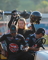 Nov 11, 2018; Pomona, CA, USA; NHRA top alcohol dragster driver Julie Nataas and crew during the Auto Club Finals at Auto Club Raceway. Mandatory Credit: Mark J. Rebilas-USA TODAY Sports