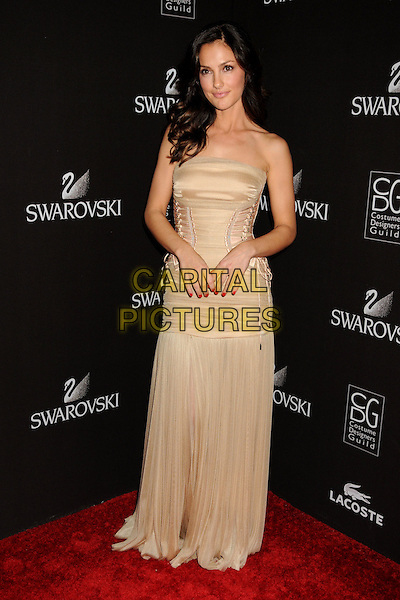 MINKA KELLY.Attending the 12th Annual Costume Designers Guild Awards held at the Beverly Hilton Hotel.  .Beverly Hills, California, USA,  .25th February 2010 .arrivals full length beige dress long maxi corset strapless ruched gold pleated  lace-up .CAP/ADM/BP.©Byron Purvis/AdMedia/Capital Pictures.