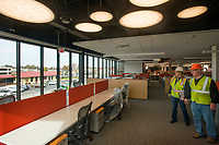 NWA Democrat-Gazette/BEN GOFF @NWABENGOFF<br /> Heather Chilson, director of corporate services with Tyson Foods, and Gordon Slothower, project manager with Tyson Foods, lead a tour Wednesday, Nov. 8, 2017, of the new Tyson Foods building in downtown Springdale. The nearly complete facility preserves and incorporates two buildings on East Emma Avenue, the former Tyson Foods headquarters and the Brown Hatchery building.