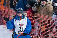 Judy Currier team leaves the start line during the restart day of Iditarod 2009 in Willow, Alaska
