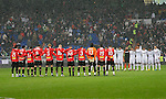 Real Madrid's and Mallorca's players onbserve a minute of silence in memory of the Togo's national team victims during La Liga match, January 10, 2010. (ALTERPHOTOS/Alvaro Hernandez).