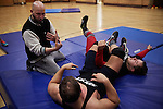 BERLIN 12.2016. Trainer and owner of GWF School Ahmad Chaer (left) with two wrestlers of GWF (German Wrestling Federation) during training.<br /> <br /> STORY: German Wrestler RAMBO MICHEL BRAUN alias EL COMANDANTE RAMBO during training at GWF Wrestling School in Berlin Neuk&ouml;lln.<br /><br />Other trainers are: Crazy Sexy mike (Hussein Chaer, man with headband) and Ahmed Chaer (man with beard) (Photo by Gregor Zielke)