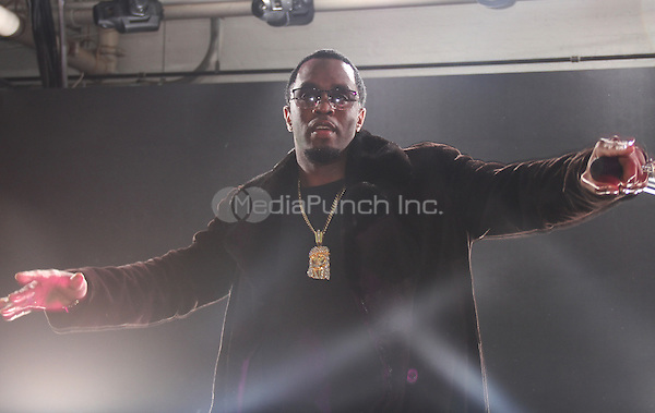 NEW YORK, NY - FEBRUARY 01: P Diddy performs at the Time Warner Cable Studios and Revolt Bring the Music Revolution event on February 1, 2014 in New York City. Photo Credit: Walik Goshorn / MediaPunch .