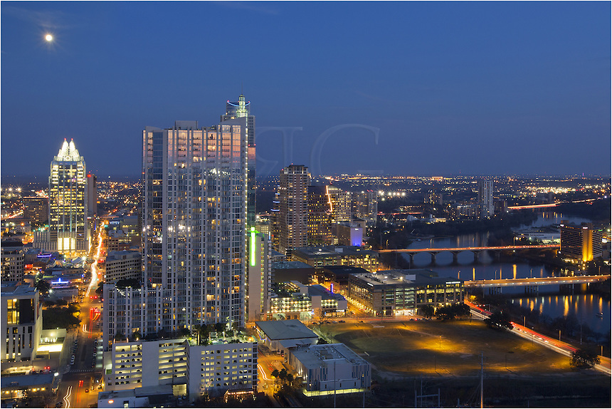 From a bird's eye vantage point, this is downtown Austin, Texas, looking east at the Frost Tower, the 360 Condominiums, Lady Bird Lake, and the Hyatt Austin. This Austin Skyline image was taken from the roof of the Springs Condominiums