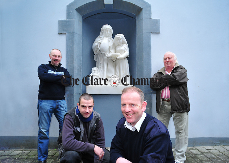JJ Counihan, left, Tidy Towns committee member, with Barry Wrafter, sculptor, Gerry Murphy, committee member, and Noel Crowley, Tidy Towns chairman, with the Sisters of Mercy sculpture at Arthur's Row. Photograph by Declan Monaghan