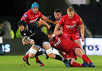 James King of the Ospreys (with ball) is brought down by Samson Lee of the Scarlets during the Guinness PRO14 Round 6 match between Ospreys and Scarlets at The Liberty Stadium , Swansea, Wales, UK. Saturday 07 October 2017