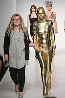 Senior fashion designer Sarah Lind, walks runway with model, at the close of the Pratt 2011 fashion show.
