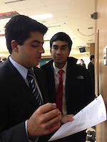 The Harker School - US - Upper School - Harker senior Anuj Sharma listens to junior Neil Khemani practice his case at the Apple Valley MN Debate Tournament - photo by Carol Green