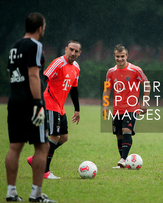 Anatoliy Tymoshchuk, Franck Ribery and Xherdan Shaqiri of Bayern Munich during a training session ahead the friendly match against VfL Wolfsburg as part of the Audi Football Summit 2012 on July 26, 2012 at the Tianhe Sports Stadium in Guangzhou, China. Photo by Victor Fraile / The Power of Sport Images