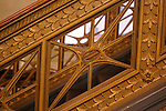 Detail of a gold railing on a staircase in the Chicago Cultural Center.