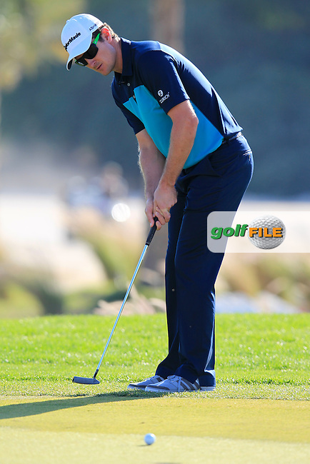 Justin Rose (ENG) putts on the 10th green during Thursday's Round 2 of the 2015 Commercial Bank Qatar Masters held at Doha Golf Club, Doha, Qatar.: Picture Eoin Clarke, www.golffile.ie: 1/22/2015