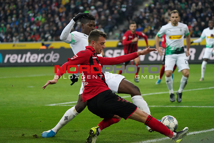01.12.2019, Borussia Park , Moenchengladbach, GER, 1. FBL,  Borussia Moenchengladbach vs. SC Freiburg,<br />  <br /> DFL regulations prohibit any use of photographs as image sequences and/or quasi-video<br /> <br /> im Bild / picture shows: <br /> JANIK HABERER (Freiburg #19), im Zweikampf gegen  Breel Embolo (Gladbach #36),  <br /> <br /> Foto © nordphoto / Meuter