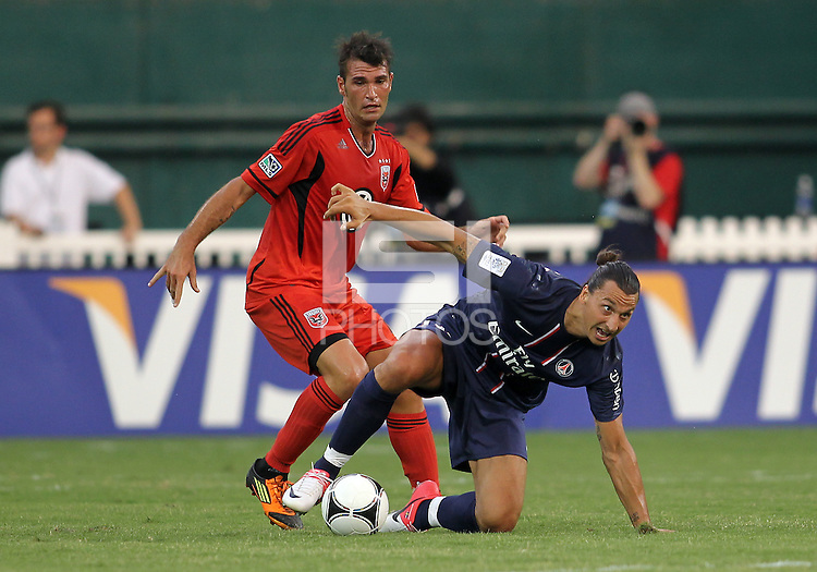 WASHINGTON, DC - July 28, 2012:  Emilliano Dudar (19) of DC United tackles Zlatan Ibrahimovic (18) of PSG (Paris Saint-Germain) in an international friendly match at RFK Stadium in Washington DC on July 28. The game ended in a 1-1 tie.