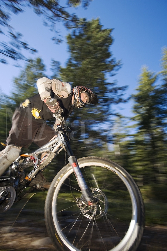 Dave Fafard accelerates on mountain bike, Alberta, Canada