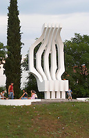 A modern white stone statue in Podgorica with a strange abstract shape. Montenegro, Balkan, Europe.