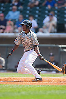 Tim Anderson (7) of the Birmingham Barons follows through on his swing against the Tennessee Smokies at Regions Field on May 3, 2015 in Birmingham, Alabama.  The Smokies defeated the Barons 3-0.  (Brian Westerholt/Four Seam Images)