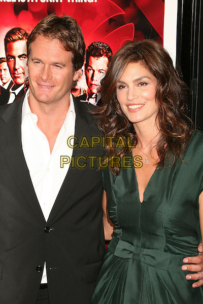 "RANDE GERBER & CINDY CRAWFORD.""Ocean's Thirteen"" Los Angeles Premiere at Grauman's Chinese Theatre, Hollywood, California, USA..June 5th, 2007.half length black suit jacket green dress married husband wife .CAP/ADM/BP.©Byron Purvis/AdMedia/Capital Pictures"