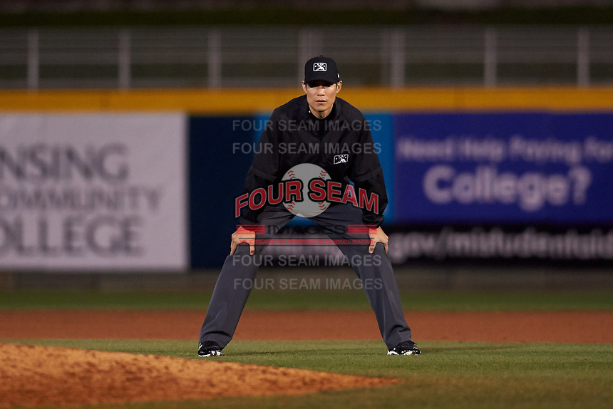 Umpire Jae-Young Kim during a Midwest League game between the Wisconsin Timber Rattlers and the Lansing Lugnuts at Cooley Law School Stadium on May 1, 2019 in Lansing, Michigan. Wisconsin defeated Lansing 2-1 in the second game of a doubleheader. (Zachary Lucy/Four Seam Images)