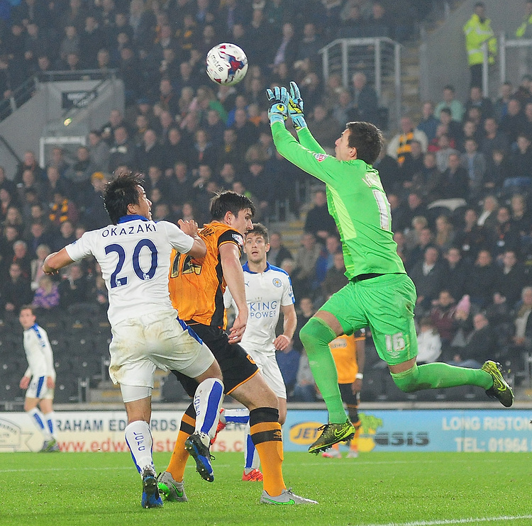Hull City's Eldin Jakupovic claims a high ball under pressure from Leicester City's Shinji Okazaki<br /> <br /> Photographer Chris Vaughan/CameraSport<br /> <br /> Football - Capital One Cup Round 4 - Hull City v Leicester City - Tuesday 27th October 2015 - Kingston Communications Stadium - Hull<br />  <br /> &copy; CameraSport - 43 Linden Ave. Countesthorpe. Leicester. England. LE8 5PG - Tel: +44 (0) 116 277 4147 - admin@camerasport.com - www.camerasport.com