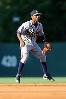 Shortstop Ozhaino Albies (7) of the Rome Braves in a game against the Greenville Drive on Friday, June 12, 2015, at Fluor Field at the West End in Greenville, South Carolina. Greenville won, 10-8. (Tom Priddy/Four Seam Images)