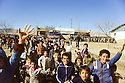Turkey 1991.In the camp near Mardin, Kurdish children waving to a group of Iraqi Kurds going to Europe