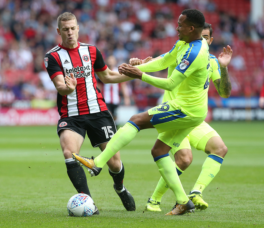 Sheffield United's Paul Coutts and Derby County's Marcus Olsson<br /> <br /> Photographer Stephen White/CameraSport<br /> <br /> The EFL Sky Bet Championship - Sheffield United v Derby County - Saturday 26th August 2017 - Bramall Lane - Sheffield<br /> <br /> World Copyright &copy; 2017 CameraSport. All rights reserved. 43 Linden Ave. Countesthorpe. Leicester. England. LE8 5PG - Tel: +44 (0) 116 277 4147 - admin@camerasport.com - www.camerasport.com