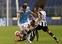 Calcio, Serie A: Lazio vs Udinese. Roma, stadio Olimpico, 13 settembre 2015.<br /> Lazio&rsquo;s Marco Parolo, left, is challenged by Udinese's Duvan Zapata, center, and Panagiotis Kone during the Italian Serie A football match between Lazio and Udinese at Rome's Olympic stadium, 13 September 2015.<br /> UPDATE IMAGES PRESS/Isabella Bonotto