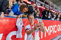 CARSON, CA - FEBRUARY 9: Lindsey Horan #9 of the United States poses for a selfie with fans during a game between Canada and USWNT at Dignity Health Sports Park on February 9, 2020 in Carson, California.