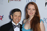 DENNIS KUCINICH, ELIZABETH KUCINICH. Red Carpet arrivals to The Art of Compassion PCRM 25th Anniversary Gala at The Lot in West Hollywood. West Hollywood, CA, USA. April 10, 2010.