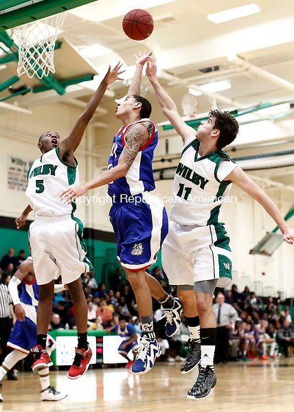Waterbury, CT- 14 January 2014-011414CM06-  Crosby's Lex Perez goes up against Wilby's Dimitri Yates (5) and Kenan Jasavic (11) during their NVL matchup in Waterbury Tuesday night. The Bulldogs topped the Wildcats, 99-69.  Christopher Massa Republican-American