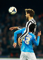 Calcio, Serie A: Napoli vs Juventus. Napoli, stadio San Paolo, 30 marzo 2014. <br /> Napoli defender Raul Albiol, of Spain, bottom, and Juventus forward Fernando Llorente, also of Spain, fight for the ball during the Italian Serie A football match between Napoli and Juventus at Naples' San Paolo stadium, 30 March 2014.<br /> UPDATE IMAGES PRESS/Isabella Bonotto