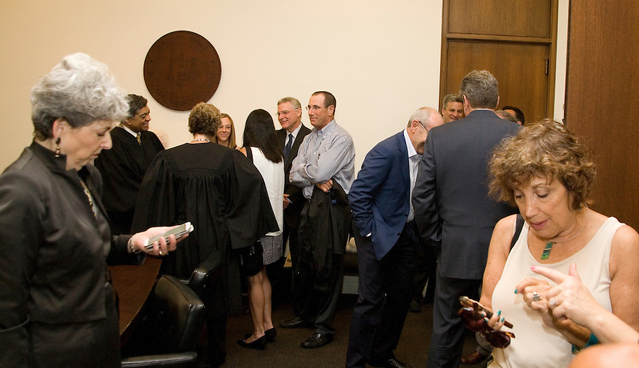Friends post pictures made at the swearing in of Abbey Fishman Romanek as a Cook County judge by Chief Justice Tim Evans on August 4, 2014. Friends and supporter came to see the peak moment after 3 campaigns over 6 years. Having won the Democratic primary in March 2014, she was appointed before the general election. After her swearing in, friends and family celebrated with Abbey.  [Photo by Karen Kring]