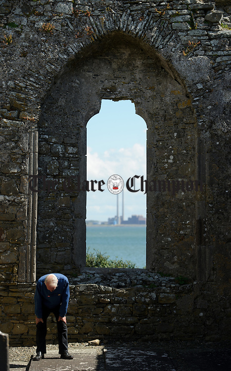 A general view of Moneypoint through the East Window of a church ruin on Scattery Island. Photograph by John Kelly.