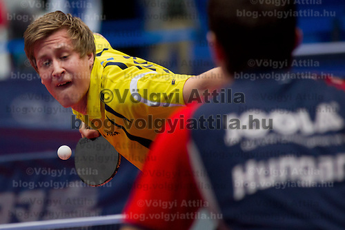 Czech Republic's Pavel Sirucek (L) plays against Hungary's Adam Szudi (R) during the qualifier of the ITTF World Tour Hungarian Open in Budapest, Hungary on January 17, 2012. ATTILA VOLGYI