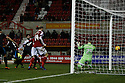 Francois Zoko of Stevenage's header beats Tyrell Belford of Swindon to equalize<br />  - Swindon Town v Stevenage - Johnstone's Paint Trophy - Southern Section Semi-final  - County Ground, Swindon - 10th December, 2013<br />  © Kevin Coleman 2013