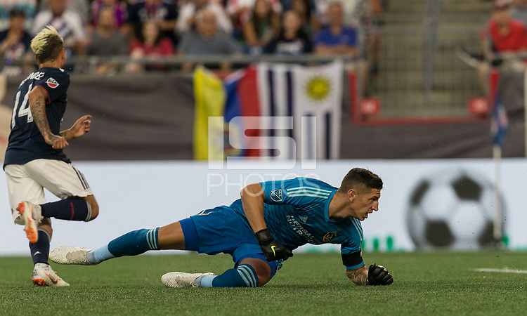 Foxborough, Massachusetts - July 14, 2018: First half action. In a Major League Soccer (MLS) match, New England Revolution (blue/white) vs Los Angeles Galaxy (white), at Gillette Stadium.<br /> Goal.