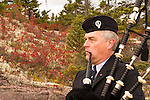 A bagpiper plays in the hills overlooking Sydney River during the Celtic Colors Festival on October18, 2008, Cape Breton Nova Scotia, Canada.  Photo by Gus Curtis.