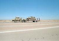Military vehicles being moved in the desert between Baghdad and the border with Jordan, while UN weapons inspectors  (February 1998) look for WMDs (weapons of mass destruction). The UNSCOM weapons inspectors left Iraq later that year.<br /> <br /> <br /> <br /> ©Fredrik Naumann/Felix Features