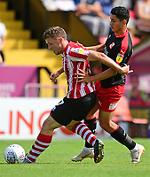 Lincoln City's Shay McCartan shields the ball from Swindon Town's Steven Alzate<br /> <br /> Photographer Chris Vaughan/CameraSport<br /> <br /> The EFL Sky Bet League Two - Lincoln City v Swindon Town - Saturday 11th August 2018 - Sincil Bank - Lincoln<br /> <br /> World Copyright &copy; 2018 CameraSport. All rights reserved. 43 Linden Ave. Countesthorpe. Leicester. England. LE8 5PG - Tel: +44 (0) 116 277 4147 - admin@camerasport.com - www.camerasport.com