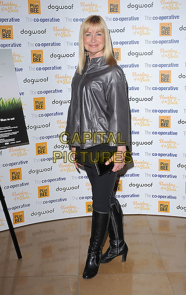 SIAN LLOYD.UK Premiere of 'The Vanishing Of The Bees' at May Fair Hotel, London, England..October 1st, 2009.full length shiny jacket top black boots clutch bag grey gray silver skirt.CAP/BEL.©Tom Belcher/Capital Pictures.